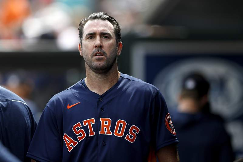 FILE - In this March 3, 2020, file photo, Houston Astros pitcher Justin Verlander walks in the dugout after pitching to the St. Louis Cardinals in the first inning of a spring training baseball game in Jupiter, Fla.  The Astros announced Saturday, Sept. 19, 2020, that Verlander needs Tommy John surgery and could miss the entire 2021 season.  (AP Photo/Julio Cortez, File)