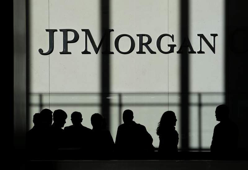 FILE - In this Monday, Oct. 21, 2013, file photo, the JPMorgan Chase logo is displayed at their headquarters in New York. Recently freed from regulators' coronavirus restrictions, the largest U.S. banks on Monday, June 28, 2021, announced plans to return tens of billions of dollars to their shareholders over the next year in the form of dividends and stock buybacks. (AP Photo/Seth Wenig, File)