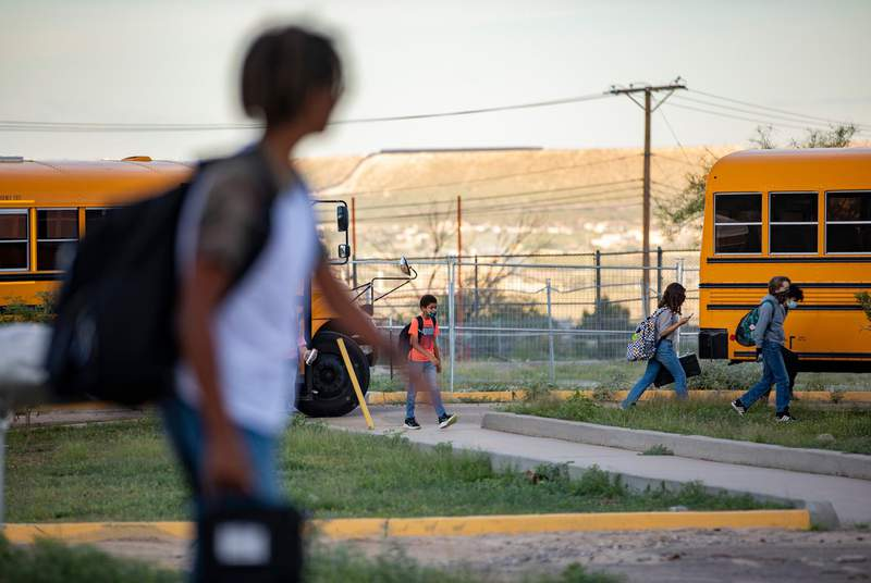 Students arrive at Morehead Middle School on Aug. 19, 2021, in El Paso. The school district, EPISD, as of today voted a mask mandate for all teachers, staff and students in school facilities, defying Gov. Abbott's order that restricted local entities from instituting mask mandates.