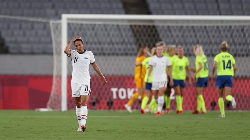 U.S. forward Christen Press reacts to Sweden scoring the last of three goals in a Tokyo Olympics group stage match.