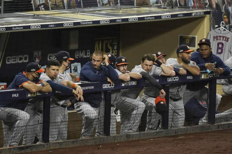 Houston Astros watch the seventh inning in Game 1 of a baseball American League Championship Series against the Tampa Bay Rays, Sunday, Oct. 11, 2020, in San Diego. (AP Photo/Ashley Landis)