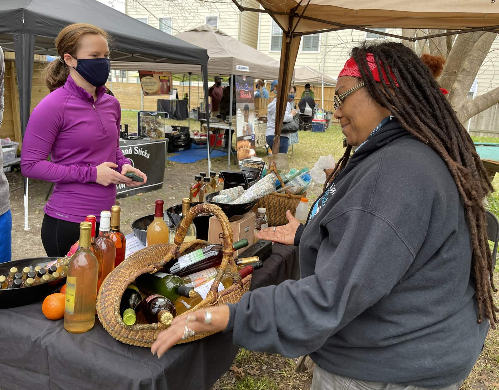 Shoppers and vendors at the Freedmen's Town Market.