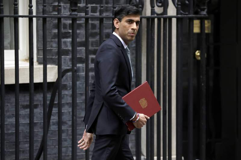 FILE - In this Wednesday, July 8, 2020 file photo, British Chancellor of the Exchequer Rishi Sunak leaves number 11 Downing Street, to deliver a financial announcement to the Houses of Parliament in London. Finance ministers from the Group of Seven wealthy democracies have a lot to talk about when they gather in London starting Friday, June 4, 2021. Ministers at the meeting chaired by Britain's Rishi Sunak and to be attended by U.S. Treasury Secretary Janet Yellen will talk about supporting the post-pandemic economic recovery and work on restoring cooperation among the seven allies after friction during the term of former President Donald Trump. (AP Photo/Matt Dunham, File)