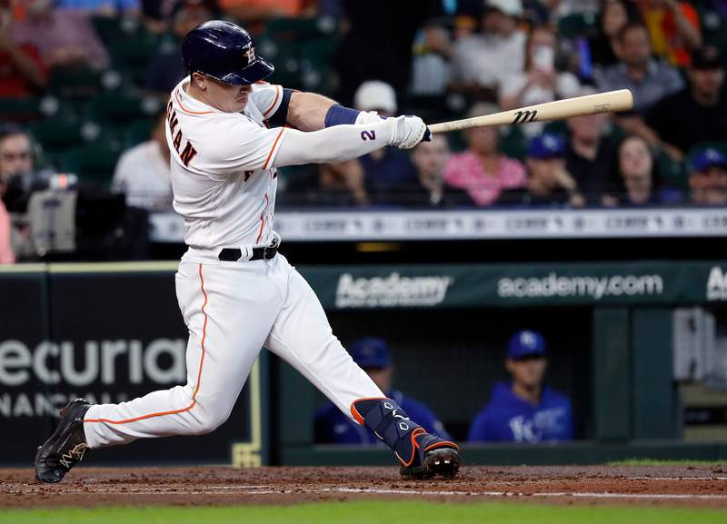 HOUSTON, TEXAS - AUGUST 25: Alex Bregman #2 of the Houston Astros pops out to shorstop Nicky Lopez #8 of the Kansas City Royals in the second inning at Minute Maid Park on August 25, 2021 in Houston, Texas. (Photo by Bob Levey/Getty Images)