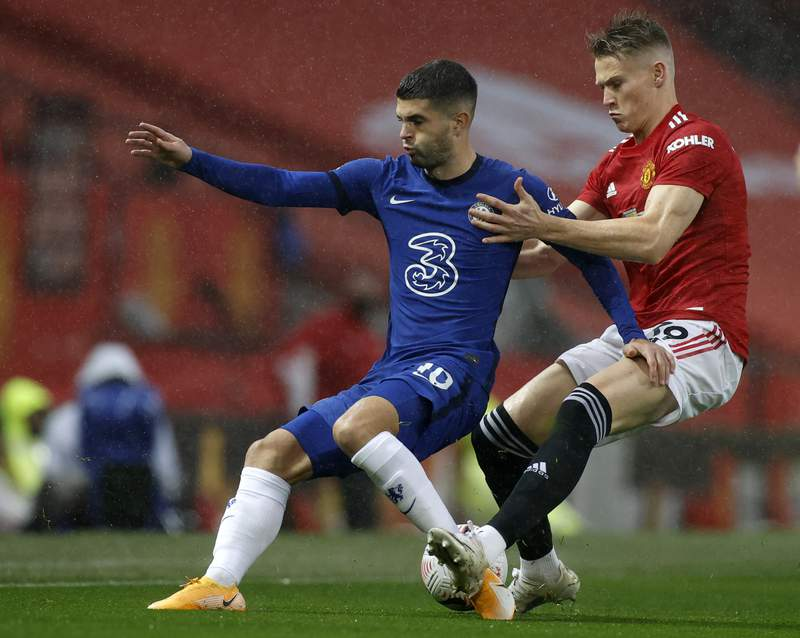 Chelsea's Christian Pulisic, left, duels for the ball with Manchester United's Scott McTominay during the English Premier League soccer match between Manchester United and Chelsea, at the Old Trafford stadium in Manchester, England, Saturday, Oct. 24, 2020. (Phil Noble/Pool via AP)