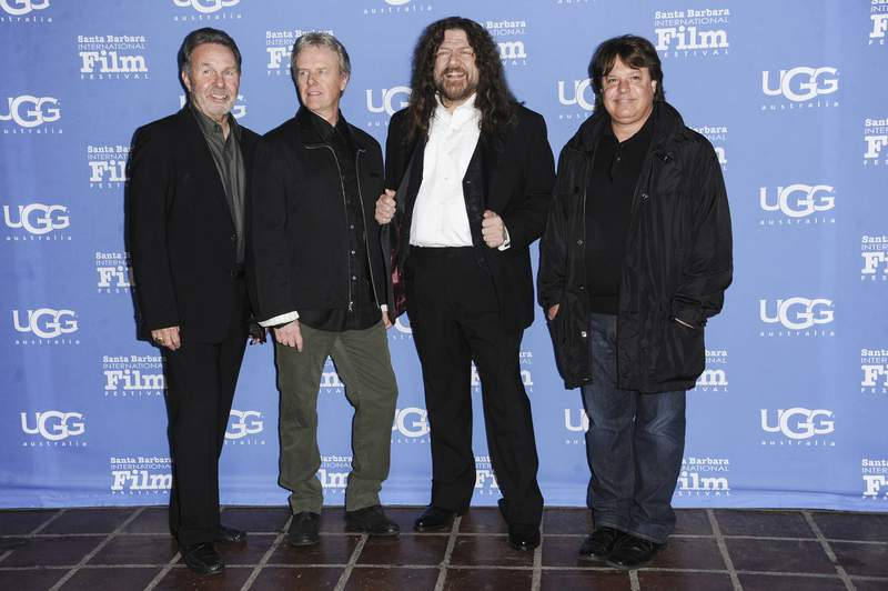 FILE - Manager Budd Carr, from left, drummer Phil Ehart and vocalist and violinist Robert E. Robby Steinhardt, of Kansas, with director Charley Randazzo arrive at the 30th Santa Barbara International Film Festival Montecito Award ceremony on Jan. 30, 2015, in Santa Barbara, Calif. Steinhardt, a native of Lawrence, Kan., who was an original member of the band, died Saturday, July 17, 2021, due to complications from pancreatitis. He was 71. (Photo by Richard Shotwell/Invision/AP, File)