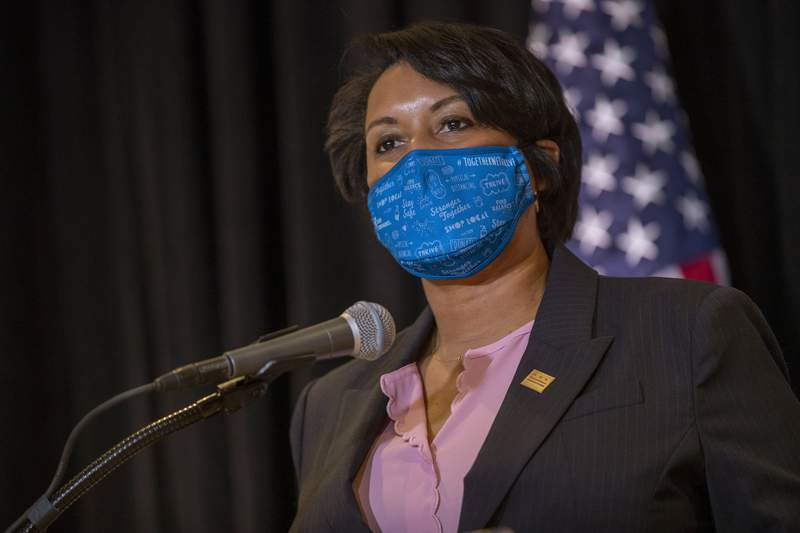 """FILE - In this Dec. 17, 2020 file photo, District of Columbia Mayor Muriel Bowser speaks during a news conference in Washington. Homicides in Detroit, New York, Philadelphia and other cities have topped 2019 numbers as violence surged while much of the U.S. struggled during the coronavirus pandemic.""""We're all sick of the heinous crimes in our city,"""" said Bowser.(Shawn Thew/Pool via AP,  File)"""
