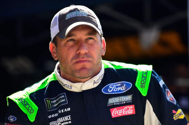 BRISTOL, TENNESSEE - AUGUST 16: Ryan Newman, driver of the #6 Acronis Ford, stands in the garage during practice for the Monster Energy NASCAR Cup Series Bass Pro Shops NRA Night Race at Bristol Motor Speedway on August 16, 2019 in Bristol, Tennessee. (Photo by Jared C. Tilton/Getty Images)