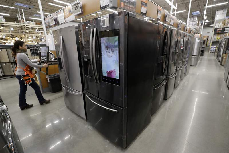 FILE - In this Jan. 27, 2020 file photo a worker pushes a cart past refrigerators at a Home Depot store location in Boston. On Thursday, May 28, the Commerce Department releases its April report on durable goods. (AP Photo/Steven Senne)