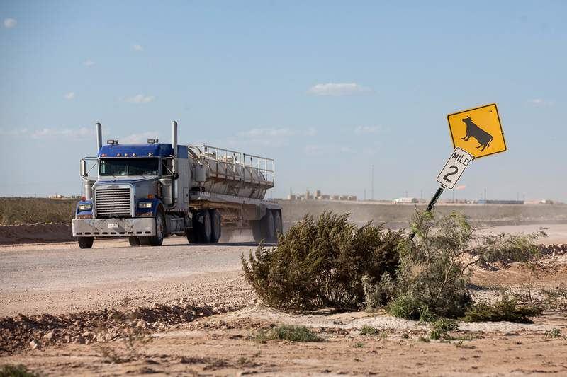A semi-truck near an oil rig site outside of Mentone on Oct. 12, 2014.