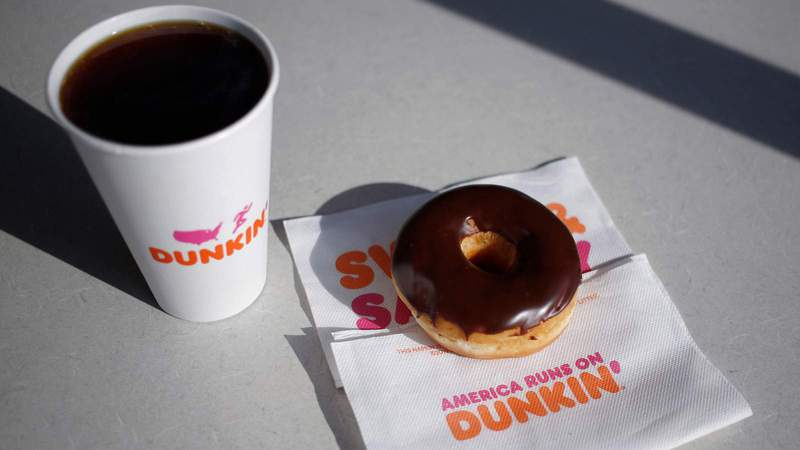 Dunkin' is giving away a free classic donut with a purchase of any drink every Friday in March, signaling the latest escalation among fast food rivals for the breakfast battle. (Luke Sharrett/Bloomberg via Getty Images)