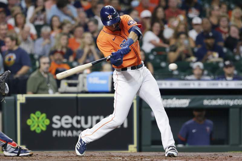 Houston Astros' Taylor Jones swings on a two-run home run against the Minnesota Twins during the second inning of a baseball game Friday, Aug. 6, 2021, in Houston. (AP Photo/Michael Wyke)
